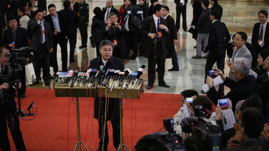 Guo Shuqing speaks to the media at the Great Hall of the People to attend a plenary session of the National People's Congress on March 10, 2013 in Beijing, China.