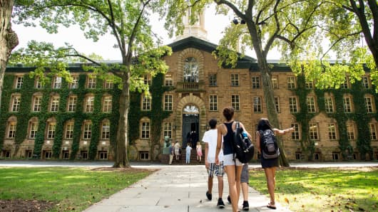 People walk on the Princeton University campus in Princeton, New Jersey.