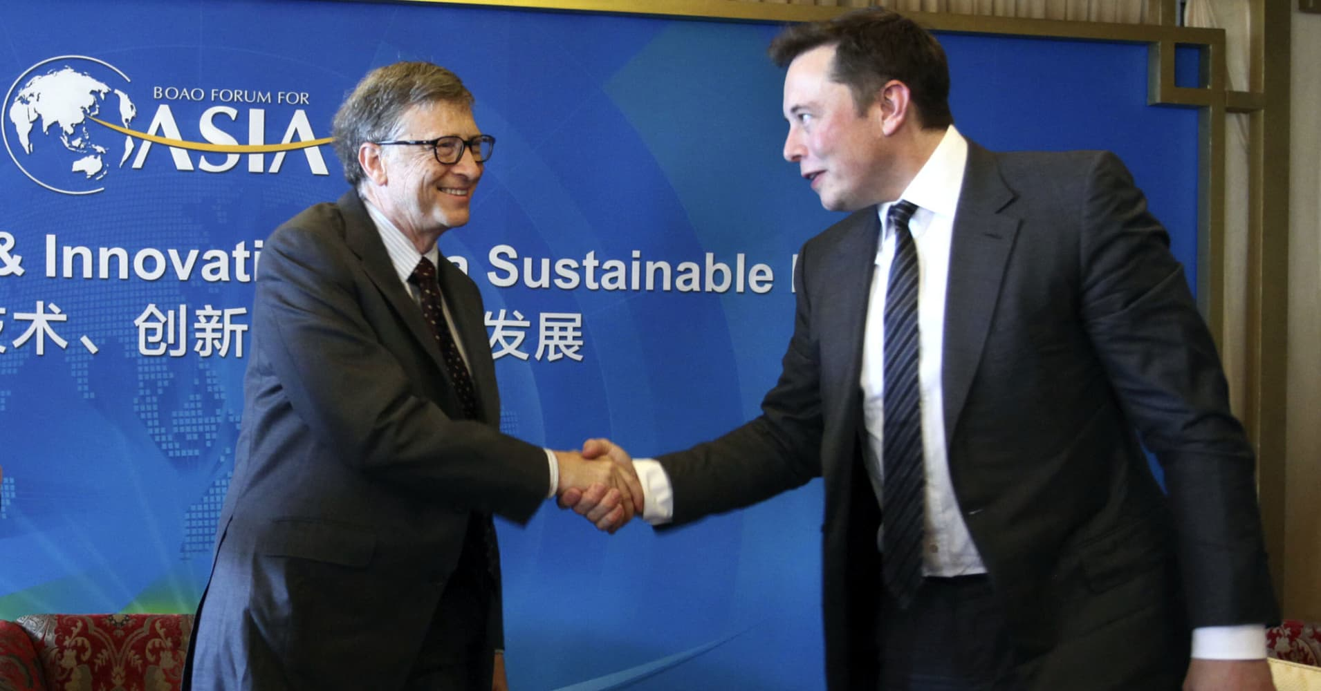 "Bill Gates and Elon Musk shake hands at a breakfast meeting with the theme ""Dialogue: Technology & Innovation for a Sustainable Future"" during the Boao Forum For Asia Annual Conference 2015 in Qionghai, China."