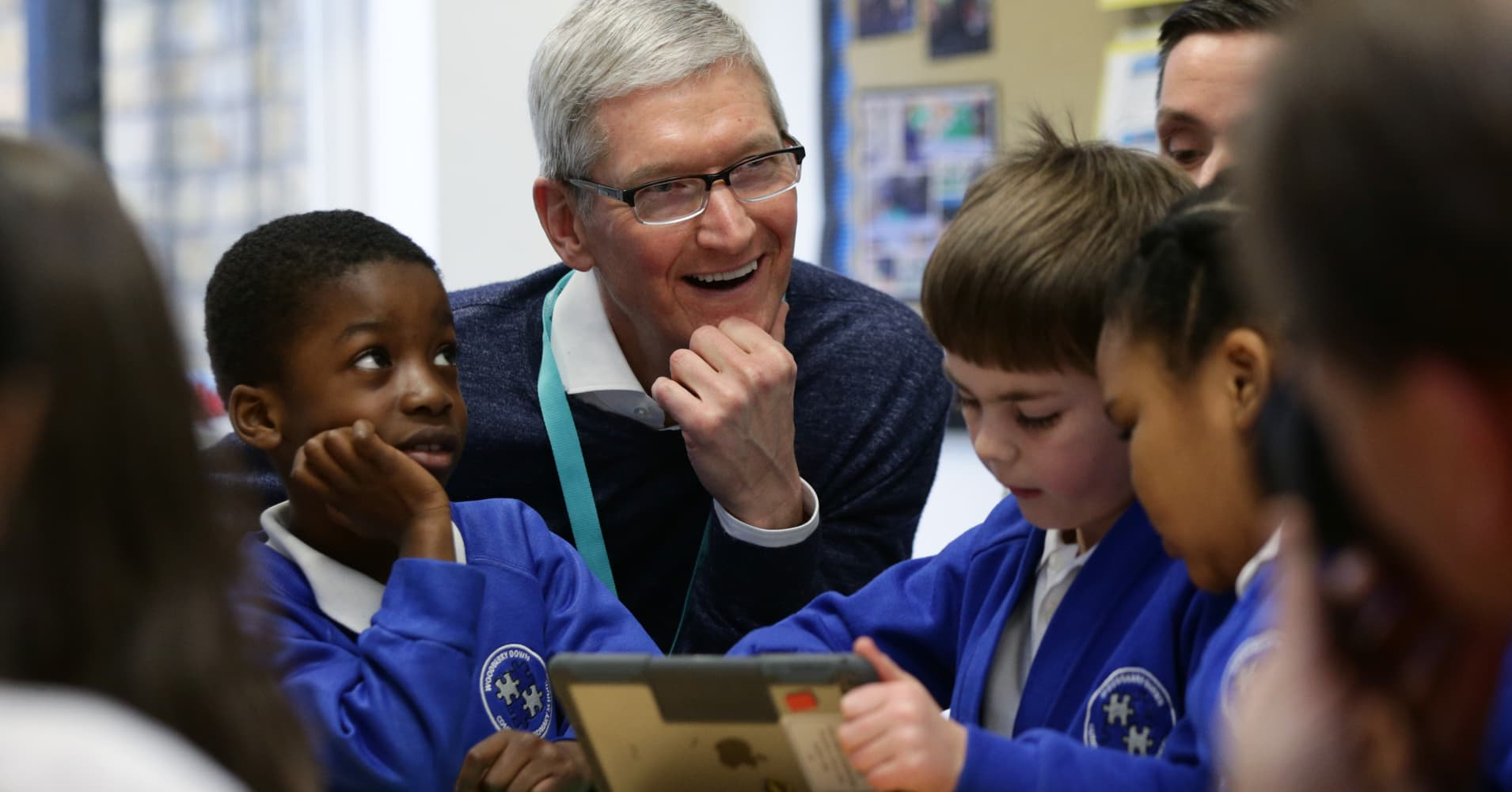 Apple chief executive Tim Cook interacts with Year 2 pupils in a classroom, during a visit to Woodberry Down Community Primary School in Harringay, north London, to view how the school, which is part of the New Wave Federation group of schools, had incorporated Apple's iPad and related software into lesson plans.