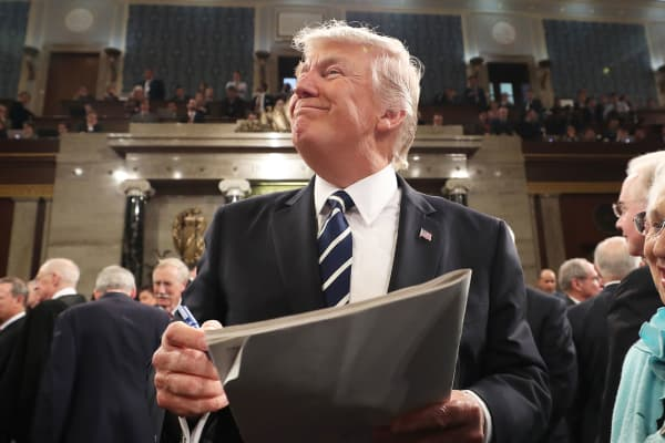 President Donald Trump, center, smiles while signing an autograph after his speech to a joint session of Congress in Washington, D.C., on Tuesday, Feb. 28, 2017.