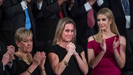 Carryn Owens, widow of Navy SEAL, William Ryan Owens, reacts after being recognized by President Donald Trump during his address to a joint session of Congress in the Capitol's House Chamber, February 28, 2017.