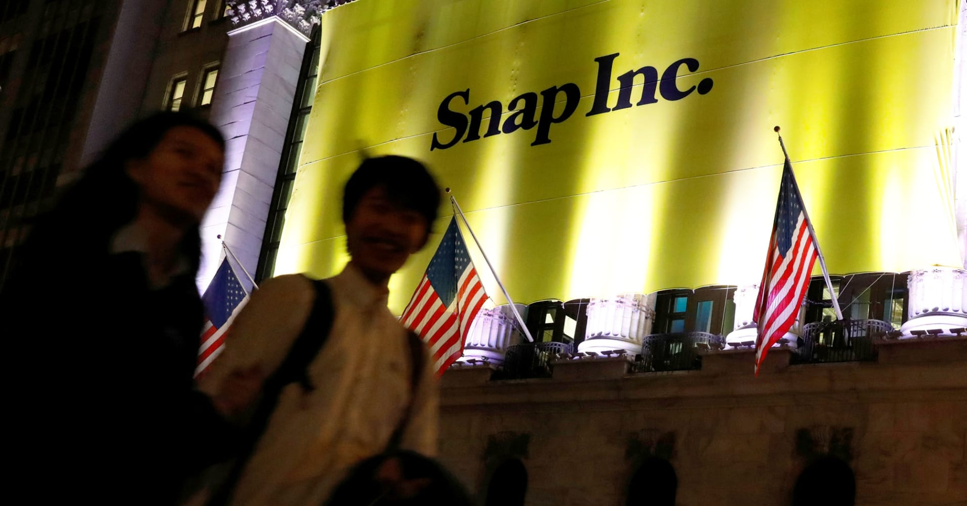 A banner for Snap Inc. hangs on the facade of the the New York Stock Exchange on the eve of the company's IPO in New York.