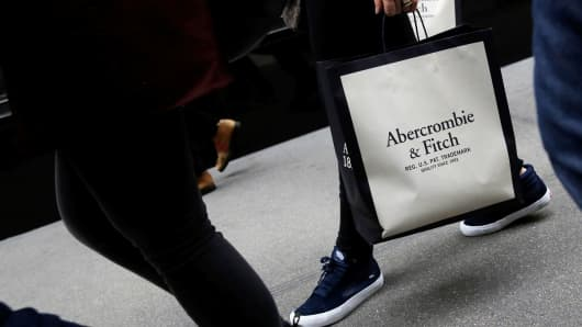 A person carries a bag from the Abercrombie & Fitch store on Fifth Avenue in New York City, February 27, 2017.