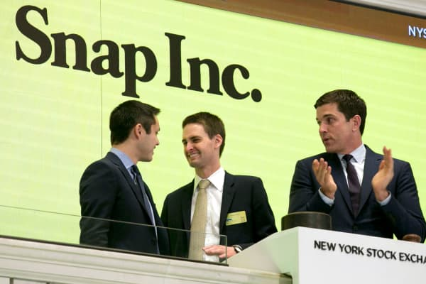 Snapchat co-founders Bobby Murphy, left, and CEO Evan Spiegel, center, ring the opening bell at the New York Stock Exchange as the company celebrates its IPO, Thursday, March 2, 2017, in New York.