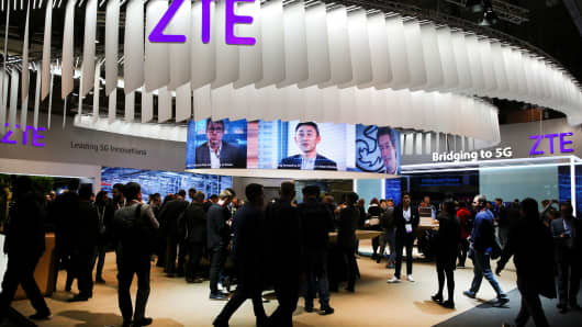 People at ZTE's booth during Mobile World Congress in Barcelona, Spain, February 27, 2017.