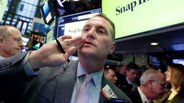 Trader Jonathan Corpina calls out to a colleague as Snap Inc. makes its Wall Street debut on the floor of the New York Stock Exchange, Thursday, March 2, 2017.