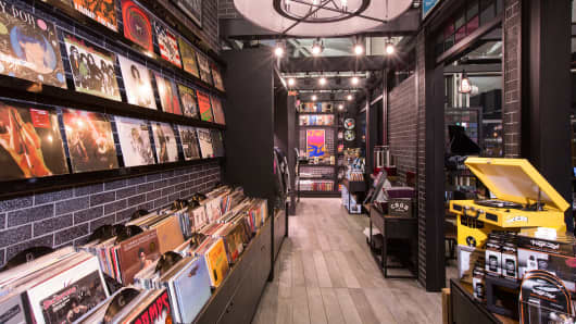 Vinyl records and record players for sale at  CBGB L.A.B. Market in Newark International Airport.