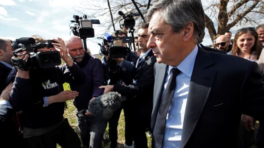 Francois Fillon, walks in vineyards, surrounded by the media, after a meeting with winegrowers in Nimes, France, March 2, 2017.