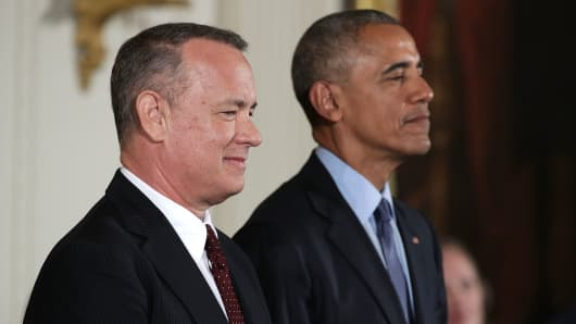 President Barack Obama stands with actor and filmmaker Tom Hanks during a Presidential Medal of Freedom presentation ceremony at the East Room of the White House November 22, 2016 in Washington, DC.