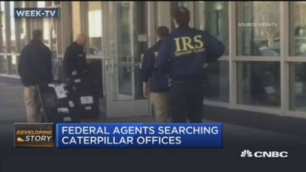 Federal agents continue to scour Caterpillar offices