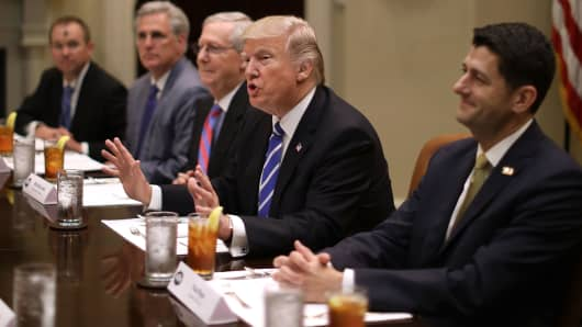President Donald Trump (C) hosts Republican Congressional leaders (2nd L-R) Rep. Kevin McCarthy (R-CA); Senate Majority Leader Mitch McConnell (R-KY), Speaker of the House Paul Ryan (R-WI) and others during a working lunch in the Roosevelt Room at the White House March 1, 2017 in Washington, DC.