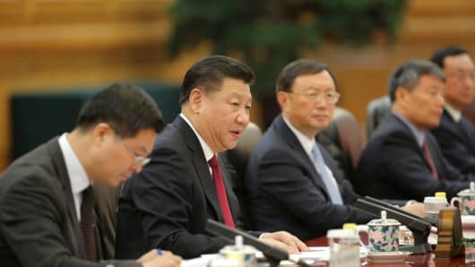 Chinese President Xi Jinping (2-L) speaks at the Great Hall of the People in Beijing, China, 22 February 2017.