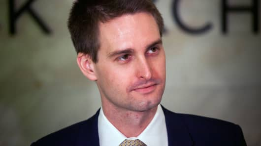 Evan Spiegel, co-founder and chief executive officer of Snap Inc., stands on the floor of the New York Stock Exchange during the company's initial public offering on Thursday, March 2, 2017.