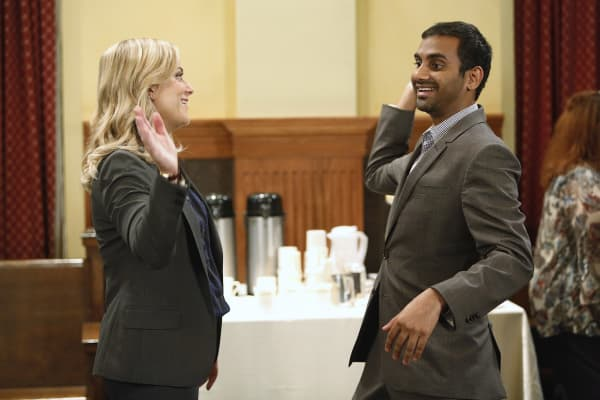 "Beloved boss Leslie Knope, character on NBC's ""Parks and Recreation"" played by Amy Poehler, high-fives employee Tom Haverford, played by Aziz Ansari."