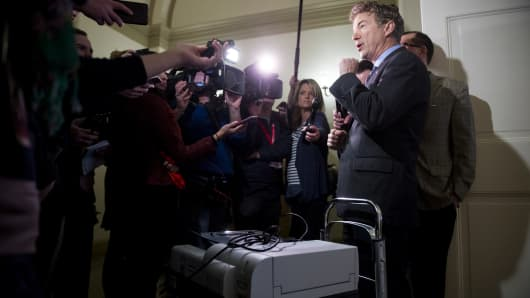Sen. Rand Paul, R-Ky., stands with his copier on a cart as he speaks to reporters after trying to gain access to the room housing the House Republicans' secret health care plan in the Capitol on Thursday, March 2, 2017. Sen. Paul hoped to make copies of the House Republicans' health care plan.