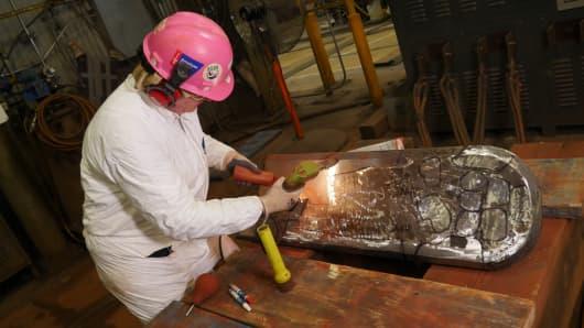 Worker at Newport News Shipbuilding facility.