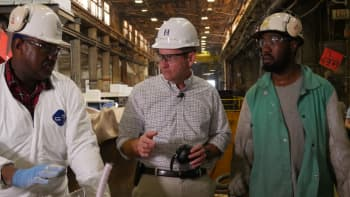 Mike Petters,  Huntington Ingalls Industries CEO with workers.