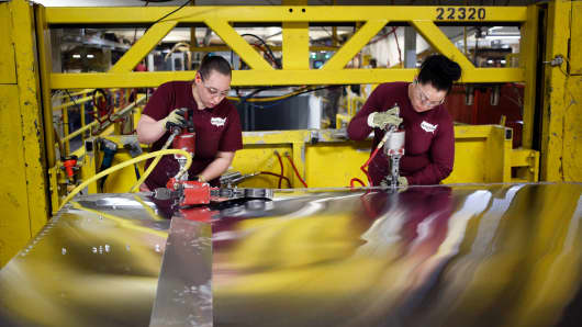 Workers assemble the roof for a semi trailer at the Wabash National Corp. manufacturing facility in Lafayette, Indiana.