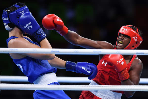 Claressa Shields of USA, right, in action against Nouchka Fontijn of Netherlands during their Women's Boxing Middleweight Final.