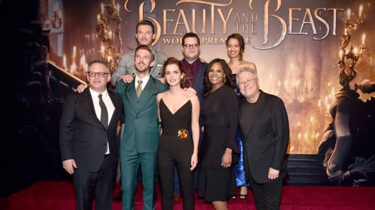 (L-R top) Actors Luke Evans, Josh Gad and Gugu Mbatha-Raw (L-R bottom) Director Bill Condon, Actors Dan Stevens, Emma Watson, Audra McDonald and Composer Alan Menken arrive for the world premiere of Disney's live-action 'Beauty and the Beast' at the El Capitan Theatre in Hollywood as the cast and filmmakers continue their worldwide publicity tour on March 2, 2017 in Los Angeles, California.