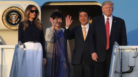 President Donald Trump and his wife Melania Trump arrive with Japanese Prime Minister Shinzo Abe and his wife Akie Abe on Air Force One at the Palm Beach International airport on February 10, 2017 in West Palm Beach, Florida.