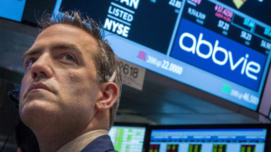 A trader works by the post that trades AbbVie on the floor of the New York Stock Exchange.
