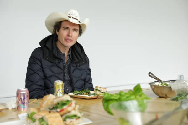 Kimbal Musk meets with Square Root farmers at the company's Brooklyn headquarters, home to farms housed in shipping containers.