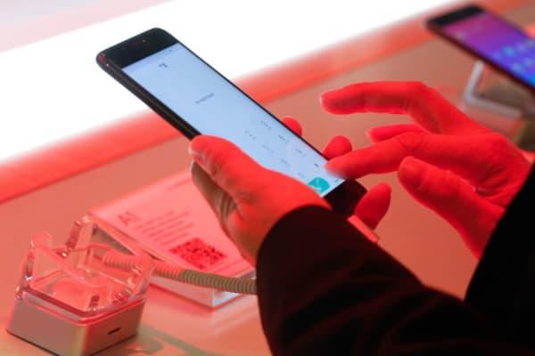An attendees uses A1 smartphone, manufactured by Gionee Communication Equipment Co. Ltd., on the opening day of the Mobile World Congress (MWC) in Barcelona, Spain, on Monday, Feb. 27, 2017.