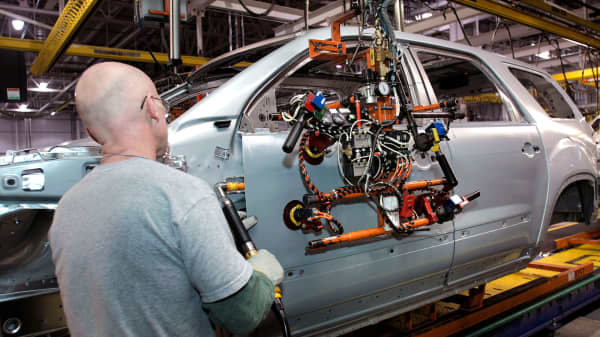 General Motors employees assemble a GM vehicle at the GM Lansing Delta Township Assembly Plant in Lansing, Michigan.