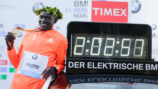 Dennis Kimetto from Kenya poses for media after winning the 41st Berlin Marathon, Sept. 28, 2014.