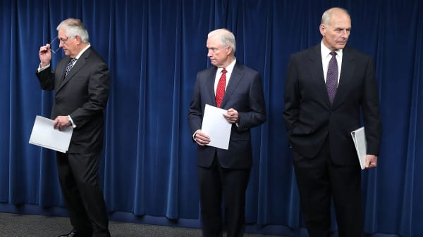 Attorney General Jeff Sessions (R), Secretary of Homeland Security John Kelly (L) and Secretary of State Rex Tillerson (C) take part in a news conference about issues related to a reconstituted travel ban at the U.S. Customs and Borders Protection headquarters, on March 6, 2017 in Washington, DC.