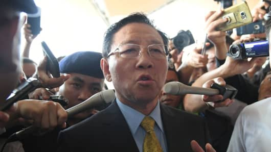 Expelled North Korean ambassador to Malaysia Kang Chol speaks to journalists outside the departure hall of the Kuala Lumpur International Airport in Sepang on March 6, 2017.
