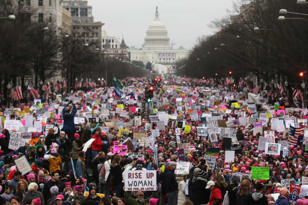 Protesters walk during the WomenÕs March on Washington, with the U.S. Capitol in the background, on January 21, 2017 in Washington, DC.