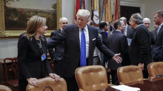 President Donald Trump greets CEO of General Motors Mary Barra (L) prior to a meeting with auto industry leaders in the Roosevelt Room of the White House on January 24, 2017 in Washington, DC.