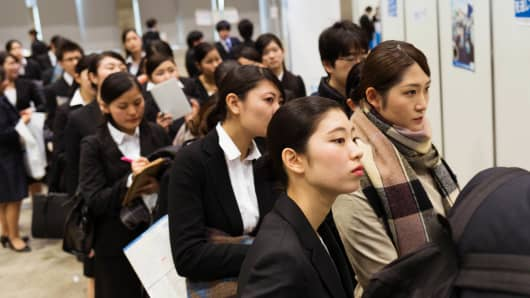 University students line up as they attend Rikunabi Live, a job fair in Chiba, Japan, on Wednesday, March 1, 2017.