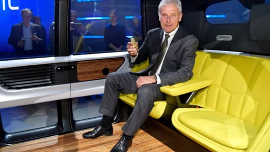 Chief Executive Officer of Volkswagen AG (VW) Matthias Mueller poses inside a Volkswagen 'Sedric' self-driving automobile during the Geneva International Motor Show on March 6, 2017.