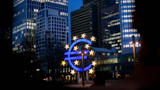 The euro sign sculpture illuminated near the former European Central Bank headquarters in Frankfurt, Germany.