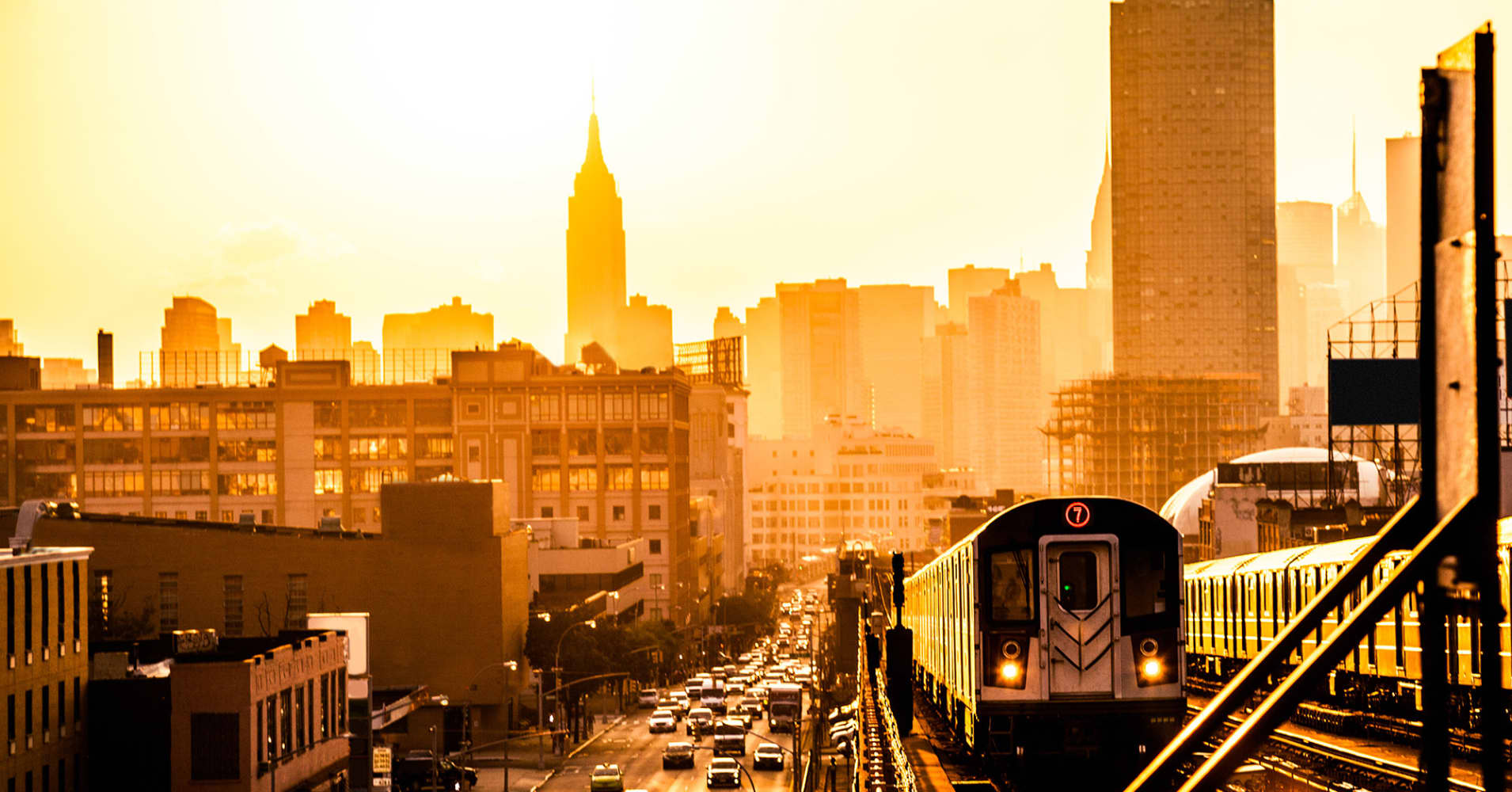 Sunset over New York skyline, on the subway overground train station.