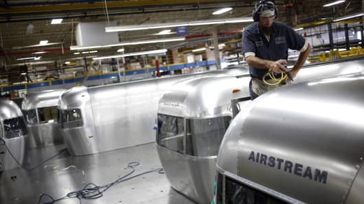 A factory worker installs rivets into the roof of an Airstream Inc. RV travel trailer on the production line at the company's assembly plant in Jackson Center, Ohio.