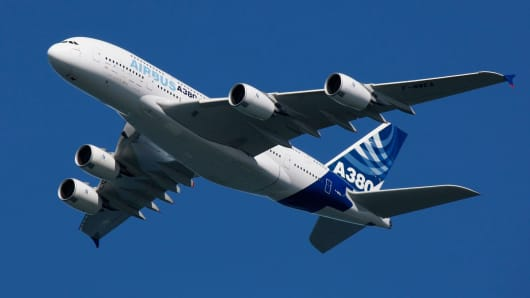 The Airbus A380 flies over San Francisco