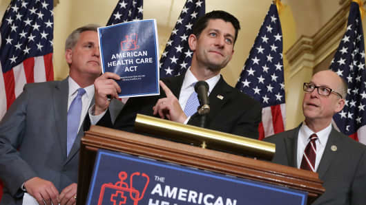 Speaker of the House Paul Ryan (R-WI) (C) holds up a copy of the American Health Care Act during a news conference with House Majority Leader Kevin McCarthy (R-CA) (L) and House Energy and Commerce Committee Chairman Greg Walden (R-OR) outside Ryan's office in the U.S. Capitol March 7, 2017 in Washington, DC.