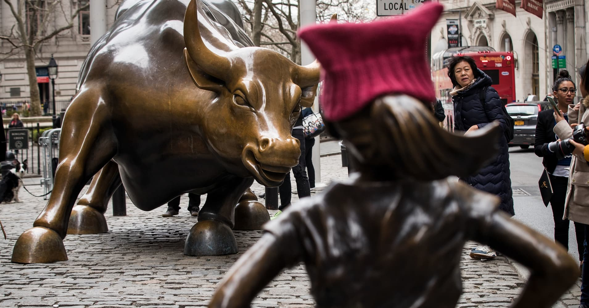 'The Fearless Girl' statues stands across from the iconic Wall Street charging bull statue, March 8, 2017 in New York City.