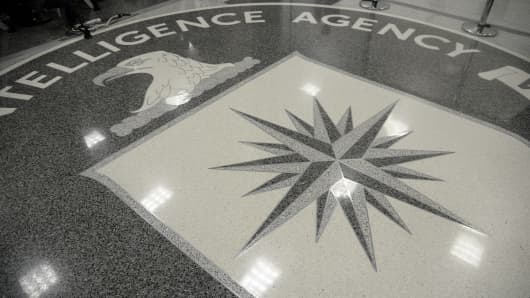The logo of the CIA is seen during a visit ofUS President Donald Trump the CIA headquarters on January 21, 2017 in Langley, Virginia .