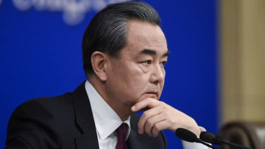 China's Foreign Minister Wang Yi prepares to answer a question at a press conference during the Fifth Session of the 12th National People's Congress (NPC) in Beijing on March 8, 2017.