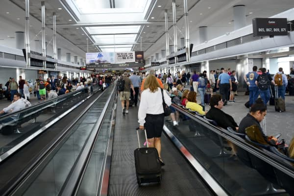 Airline passengers use the moving walkways at Denver International Airport in Denver, Colorado.