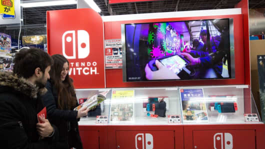 Japanese gamers buy the new video game Nintendo Switch games console by Nintendo Co. during the first day of sales worldwide in Tokyo, Japan on March 03, 2017.