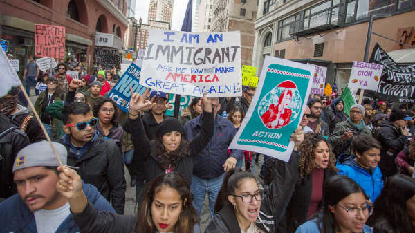 Protesters participate in the Immigrants Make America Great March to protest actions being taken by the Trump administration on February 18, 2017 in Los Angeles, California.