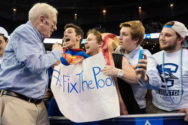 Billionaire Warren Buffett of Berkshire Hathaway poses with Creighton Bluejay fans.