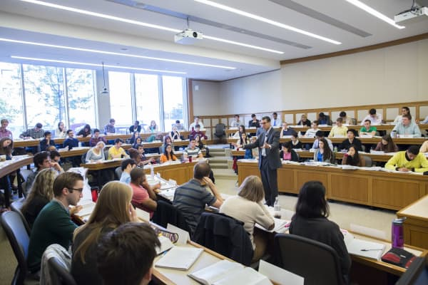 Students attend a class at Harvard Law School